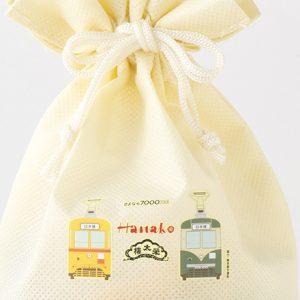 2色の7000形が描かれた特製きんちゃく付き!榮太樓飴と果汁飴のスペシャルセット。
