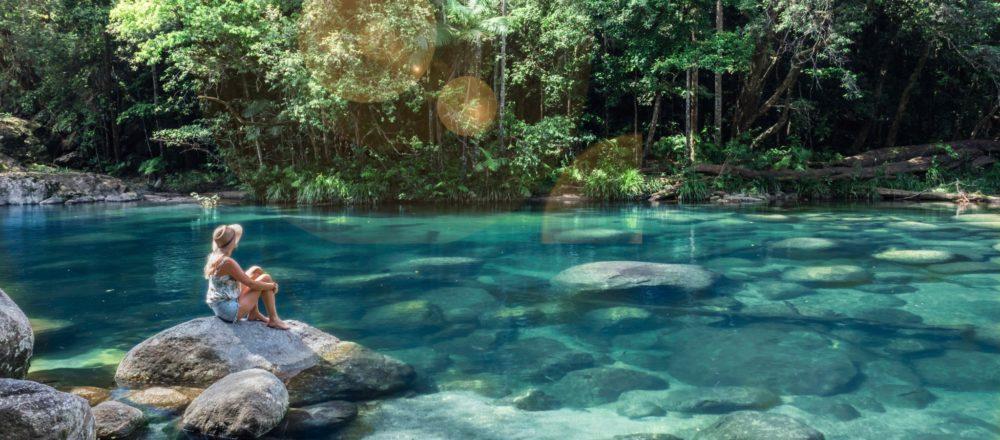 Sitting on a rock amongst the rainforest